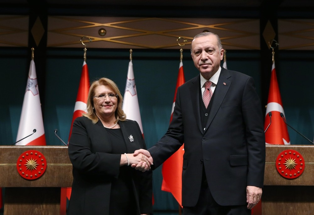 President Recep Tayyip Erdou011fan (R) and Malta's President Marie-Louise Coleiro Preca shake hands after holding a joint press conference in Ankara, Jan. 24, 2019.