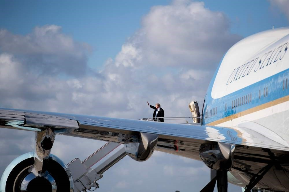 U.S. President Donald Trump boards Air Force One at Palm Beach International Airport, West Palm Beach, Florida.