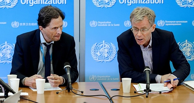 World Health Organization (WHO) Executive Director of the Outbreak and Health Emergencies Cluster Bruce Aylward (R) and Chairman of the World Health Organization (WHO) Emergency Committee, Professor David L. Heymann (AFP Photo)