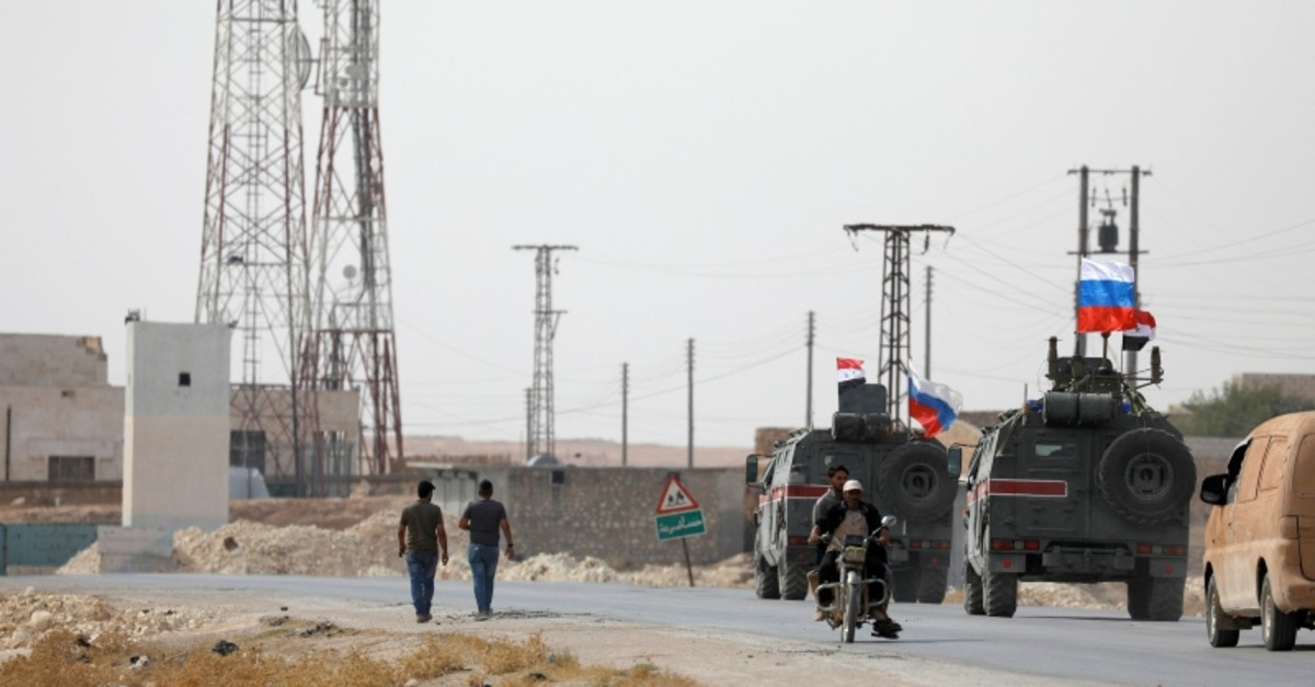 Russian and Syrian national flags flutter on military vehicles near Manbij, Syria, Oct. 15, 2019. (Reuters Photo)
