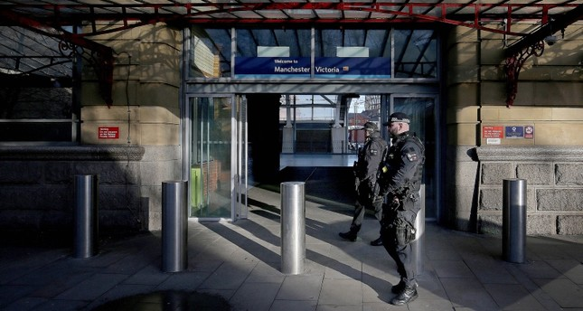 A general view of police officers at Manchester Victoria Metrolink station, in Manchester, north west England, January 1, 2019, following the stabbing of three people. (EPA Photo)