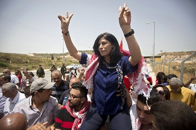 Palestinian lawmaker Khalida Jarrar is greeted by supporters after her release from an Israeli prison at the Jabara checkpoint near the West Bank town of Tulkarem, June 3, 2016. (AP Photo)