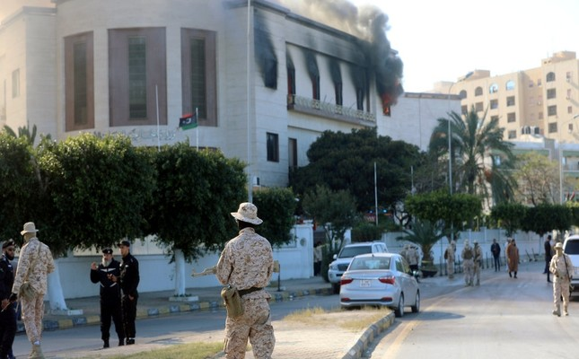 Security forces stand around the headquarters of Libya's Foreign Ministry after a suicide attack, Tripoli, Dec. 25, 2018.