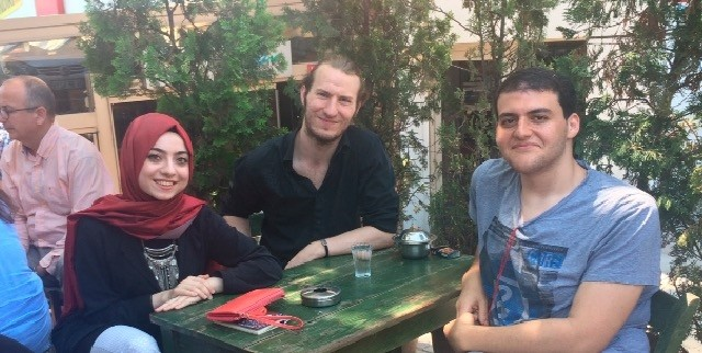 Thomas Parker (C) and Mohamad Shalaby(R), who are the expats that live in Turkey and experienced last yearu2019s coup attempt, with Daily Sabah Reporter u015eeyma Nazlu0131 Gu00fcrbu00fcz.