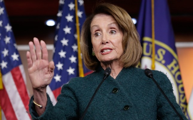 In this Jan. 10, 2019 photo, Speaker of the House Nancy Pelosi, D-Calif., meets with reporters in her first formal news conference, on Capitol Hill in Washington.   Pelosi has asked President Donald Trump to postpone his State of the Union address to