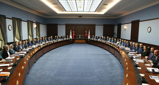 President Recep Tayyip Erdoğan (C) chairs the first meeting of the ruling AK Party's executive members, a week after being elected as the party chairman, Ankara, May 29.