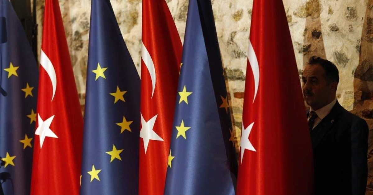 The Turkish and EU flag at the opening session of a high-level meeting to improve economic and business ties between the EU and Turkey in Istanbul, Feb. 28, 2019. (AP Photo)
