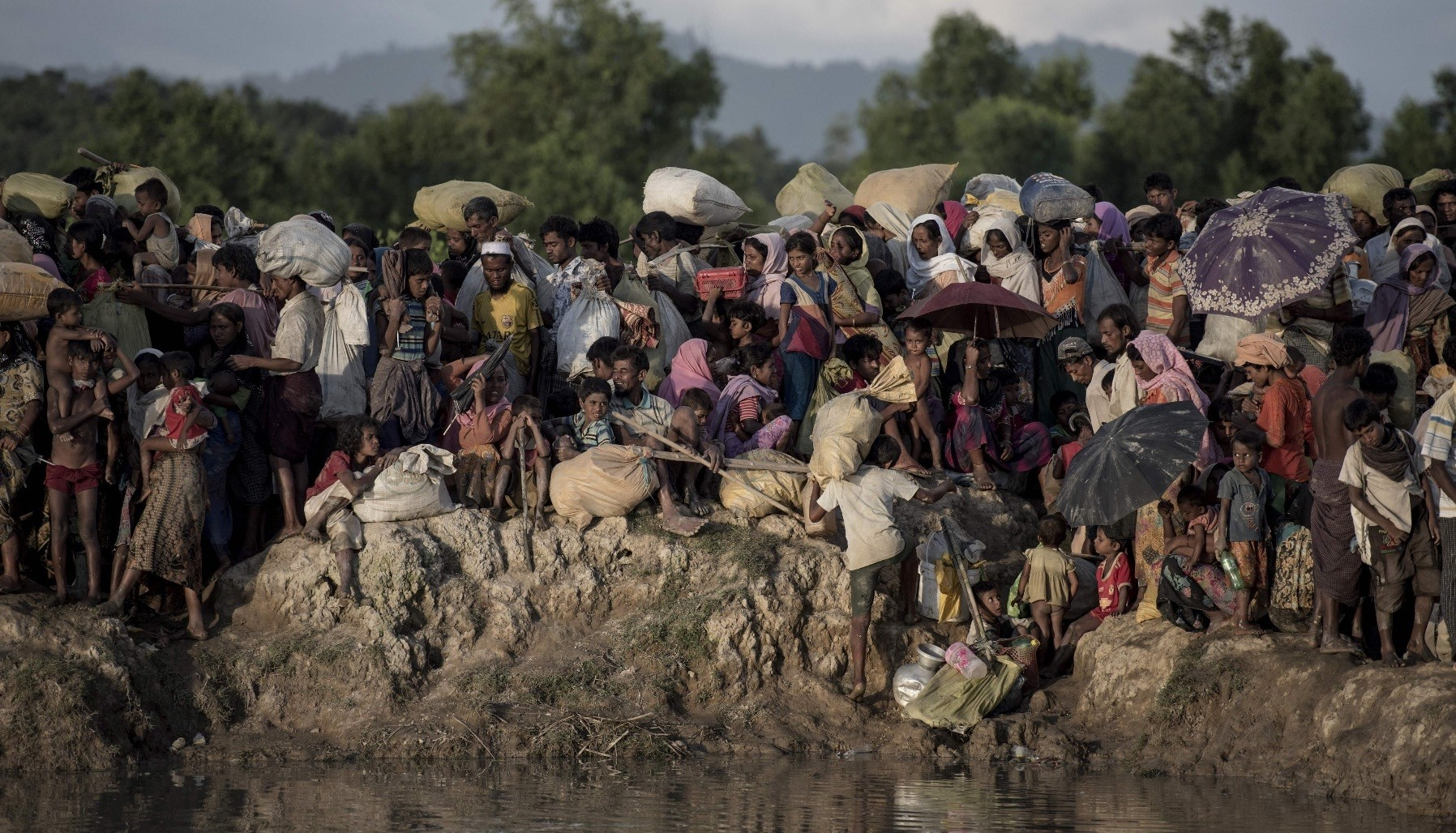 Rohingya refugees fleeing Myanmar arrive at the Naf river, Whaikyang, Bangladesh, Oct. 10, 2017.