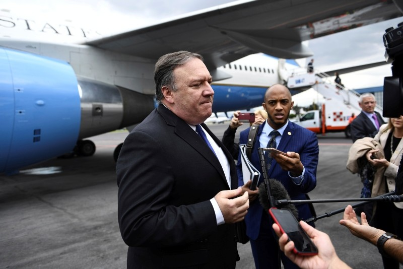 U.S. Secretary of State Mike Pompeo speaks to reporters before boarding his plane at the Mexico City International Airport on Friday, Oct. 19, 2018. (AP Photo)