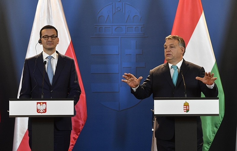 Staying on an official visit in Hungary new Polish Prime Minister Mateusz Morawiecki, left, listens to his Hungarian counterpart Viktor Orban during their joint news conference in Budapest, Hungary, Wednesday, Jan. 3, 2018. (AP Photo)