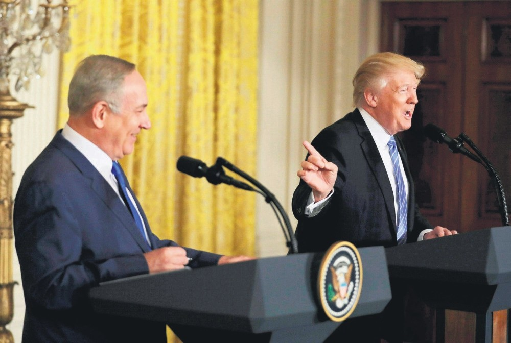 U.S. President Donald Trump laughs with Israeli Prime Minister Benjamin Netanyahu at a joint news conference at the White House in Washington, Feb. 15.