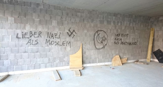 This file photo dated July 7, 2016 shows neo-Nazi slogans and a swastika sprayed on the walls of a Turkish-Islamic Union for Religious Affairs (DITIB) mosque under construction in Herringen, North-Rhine Westphalia, Germany. (AA Photo)