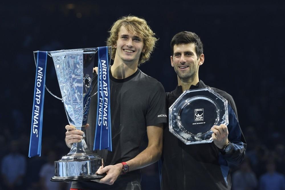 Alexander Zverev (left) and Novak Djokovic pose with their awards.