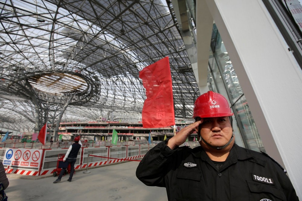 A security guard salutes at the terminal hall of the new Daxing Airport in Beijing.