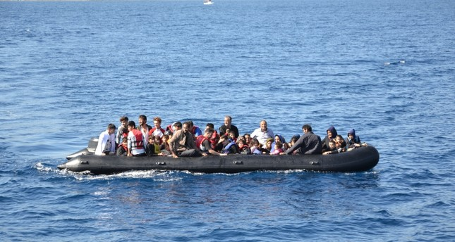 A group of illegal Afghan migrants aboard a boat off the coast of Ayvacık in western Turkey, Oct. 15, 2019. (DHA Photo)
