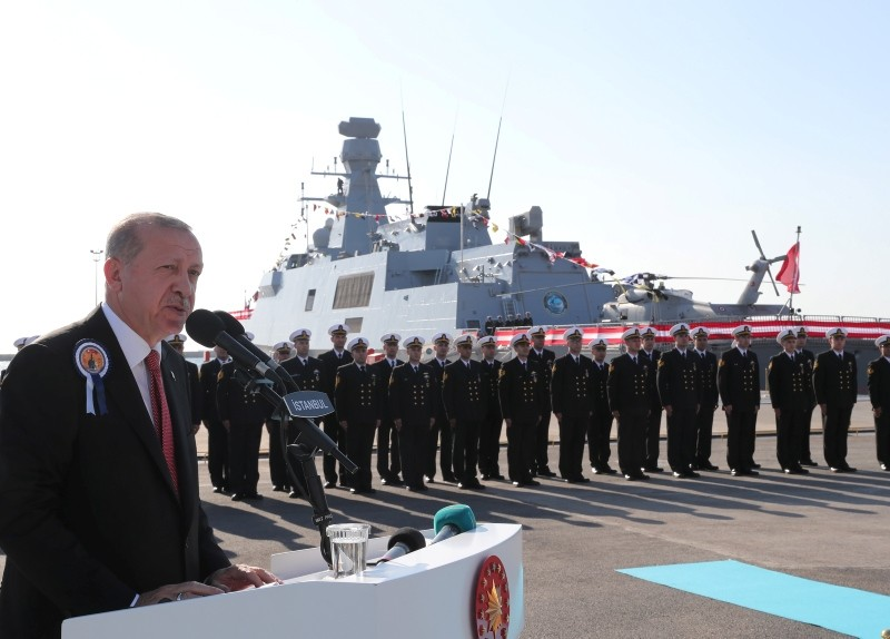 President Recep Tayyip Erdou011fan speaks at a ceremony for the handover of the TCG Burgazada corvette (in the background) to the Turkish Navy at the Istanbul Shipyard Command, on Nov. 4, 2018. (Presidential Photo Service)