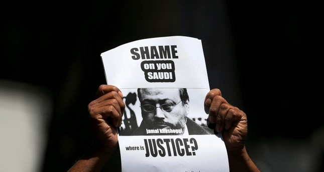 A member of Sri Lankan Web Journalist Association holds a placard during a protest condemning the murder of slain journalist Jamal Khashoggi in front of the Saudi embassy in Colombo, Sri Lanka, October 25, 2018. (Reuters Photo)