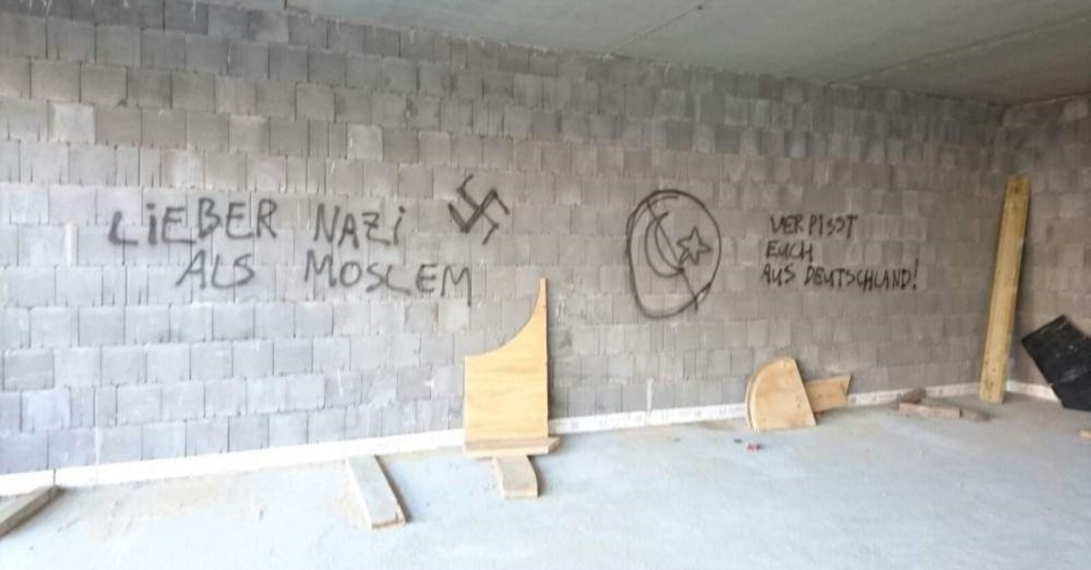 This 2016 photo shows anti-Muslim and anti-Turk slogans written on an under-construction mosque in the German city of Herringen. (AA Photo)