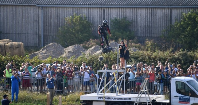 Franky Zapata (C) stands on his jet-powered flyboard as he takes off from Sangatte, northern France, attempting to fly across the 35-kilometre (22-mile) Channel crossing in 20 minutes (AFP Photo)