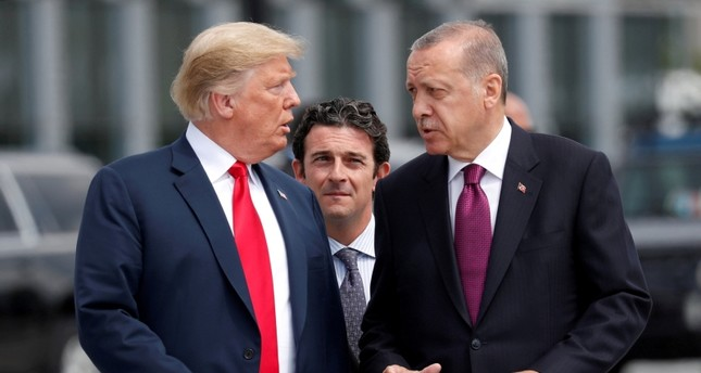 U.S. President Donald Trump and Turkish President Tayyip Erdogan gesture as they talk at the start of the NATO summit in Brussels, Belgium July 11, 2018.  (REUTERS Photo)