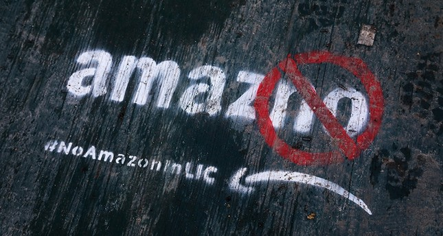 In this Nov. 16, 2018, file photo graffiti has been painted on a sidewalk by someone opposed to the location of an Amazon headquarters in the Long Island City neighborhood in the Queens borough of New York. AP Photo