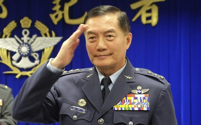 In this March 7, 2019, file photo, Taiwanese top military official Shen Yi-ming salutes as he is introduced to journalists during a press conference in Taipei, Taiwan. AP Photo