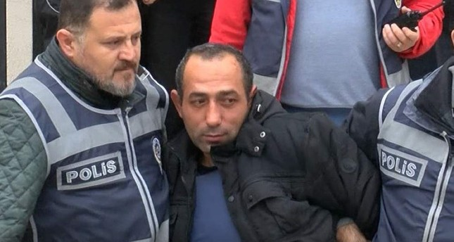The defendant Arduç was brought to the courtroom under heavy security measures. DHA Photo