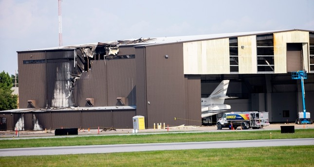 Damage is seen to a hangar after a twin-engine plane crashed into the building at Addison Airport in Addison, Texas, Sunday, June 30, 2019. (AP Photo)