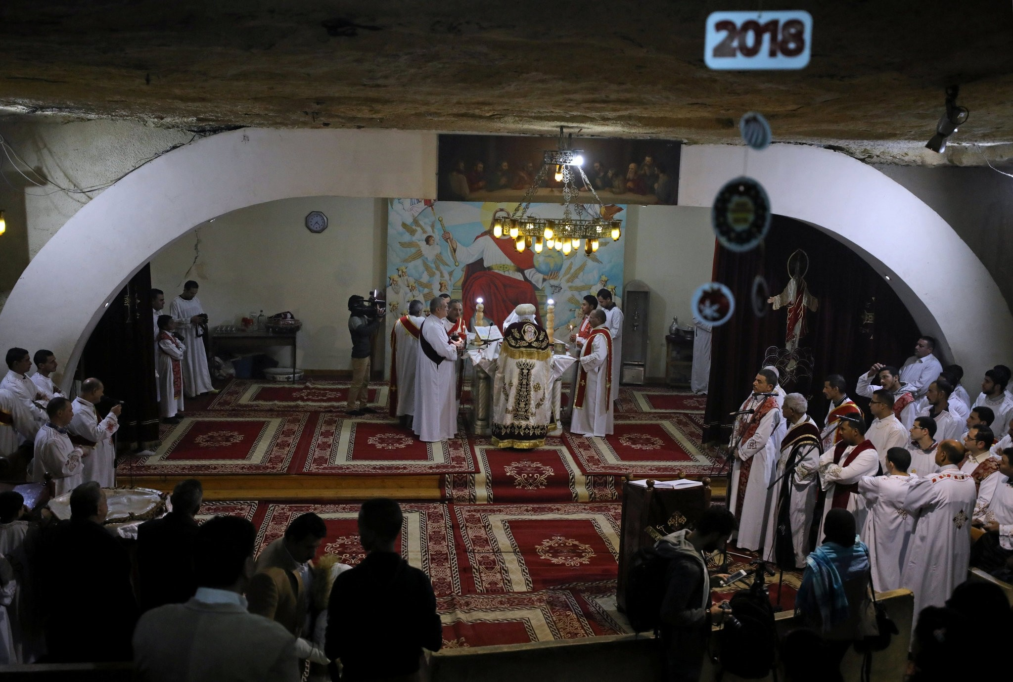 Coptic Orthodox Christian priests and deacons attend Christmas eve mass at a church in Saint Samaan the tanner Monastery in Cairo, Egypt January 6, 2018. (REUTERS Photo)