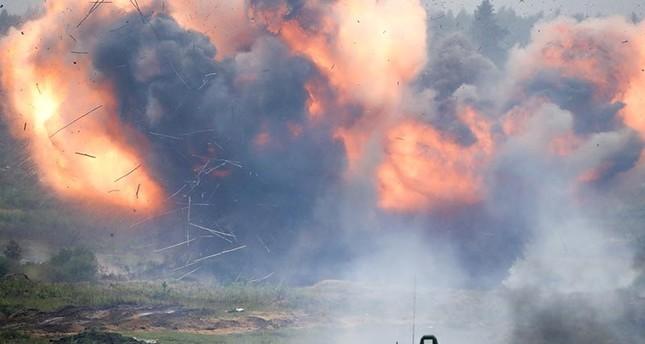 Shells explode during the Zapad (West) 2017 Russia-Belarus military exercises at the Borisovsky range in Borisov, Belarus, Wednesday, Sept. 20, 2017. (AP Photo)