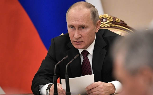 Russian President Vladimir Putin heads the Security Council meeting in Moscow, Russia, Thursday, Oct. 26, 2017. (Alexei Nikolsky, Sputnik, Kremlin Pool Photo via AP)