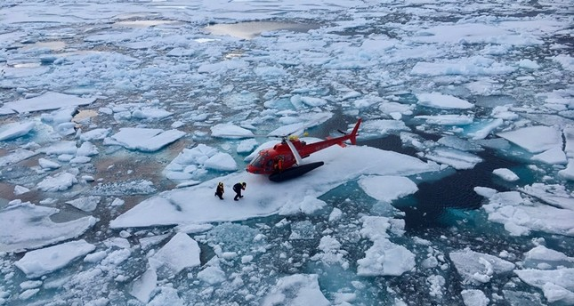 A helicopter from the Swedish icebreaker Oden lands on an ice floe to pick up crew members involved in the retrieval of a scientific acoustic recorder containing valuable data on Arctic marine life  movements in the Canadian Arctic (Reuters Photo)