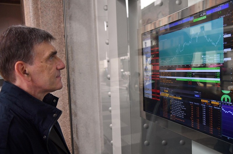 A man looks on a screen the spreads at 'Borsa di Milano' stock market in Milan, Italy, Oct. 11, 2018. (EPA Photo)