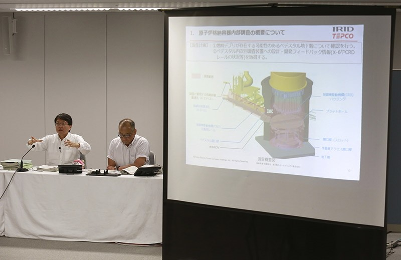 Tokyo Electric Power Co. (TEPCO) spokesmen Takahiro Kimoto, left, and Sadanobu Kanno attend a press conference on sending an underwater robot into Fukushima plant to search for melted fuel at the TEPCO HQ in Tokyo Wednesday, July 19, 2017. (AP Photo)