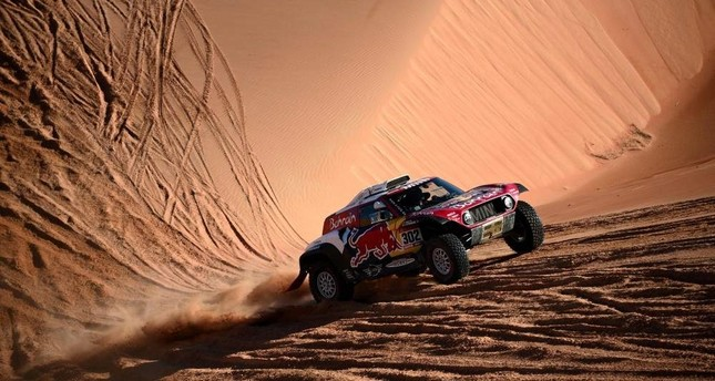 Stephane Peterhansel and his co-driver Portuguese Paulo Fiuza compete during the Stage 11 of the rally between Shubaytah and Haradh, Saudi Arabia, Jan. 16, 2020. AFP Photo