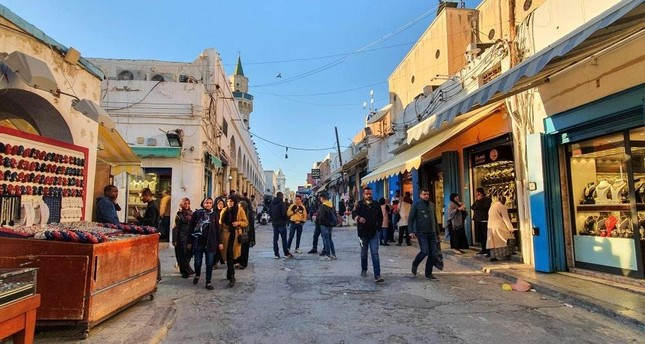 Libyans take a stroll on a shopping street in the old quarter of the capital Tripoli, Jan. 20, 2020. AFP PHOTO