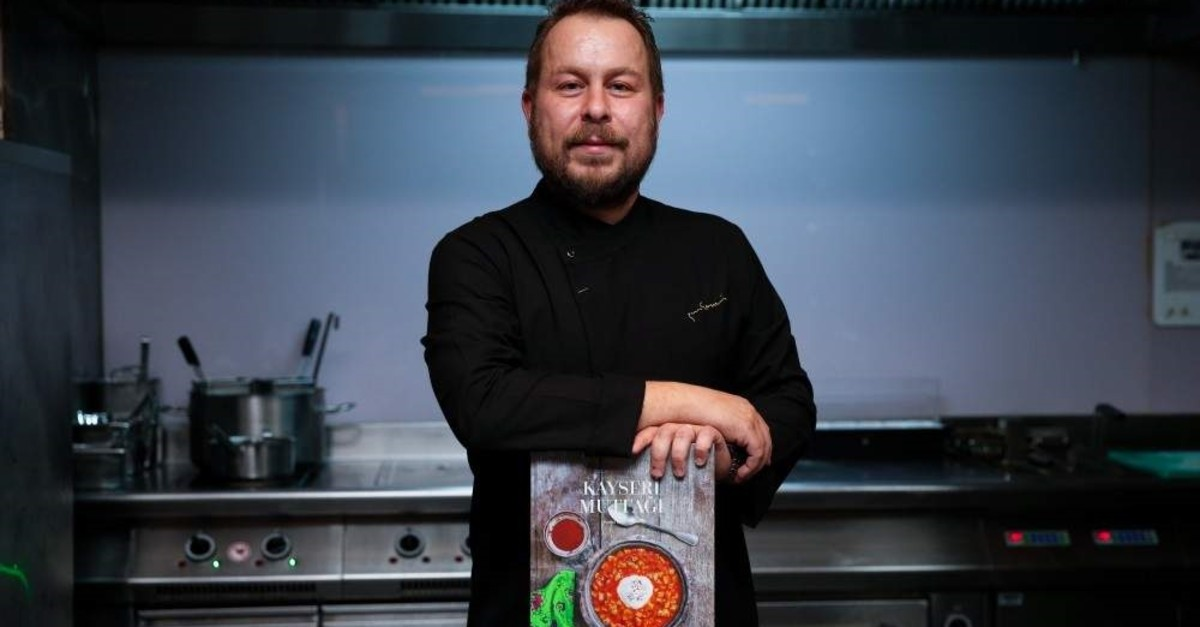 Chef Yunus Emre Akkor poses with the book that earned him a ,Gourmand Cook Book Award.,  (AA Photo)