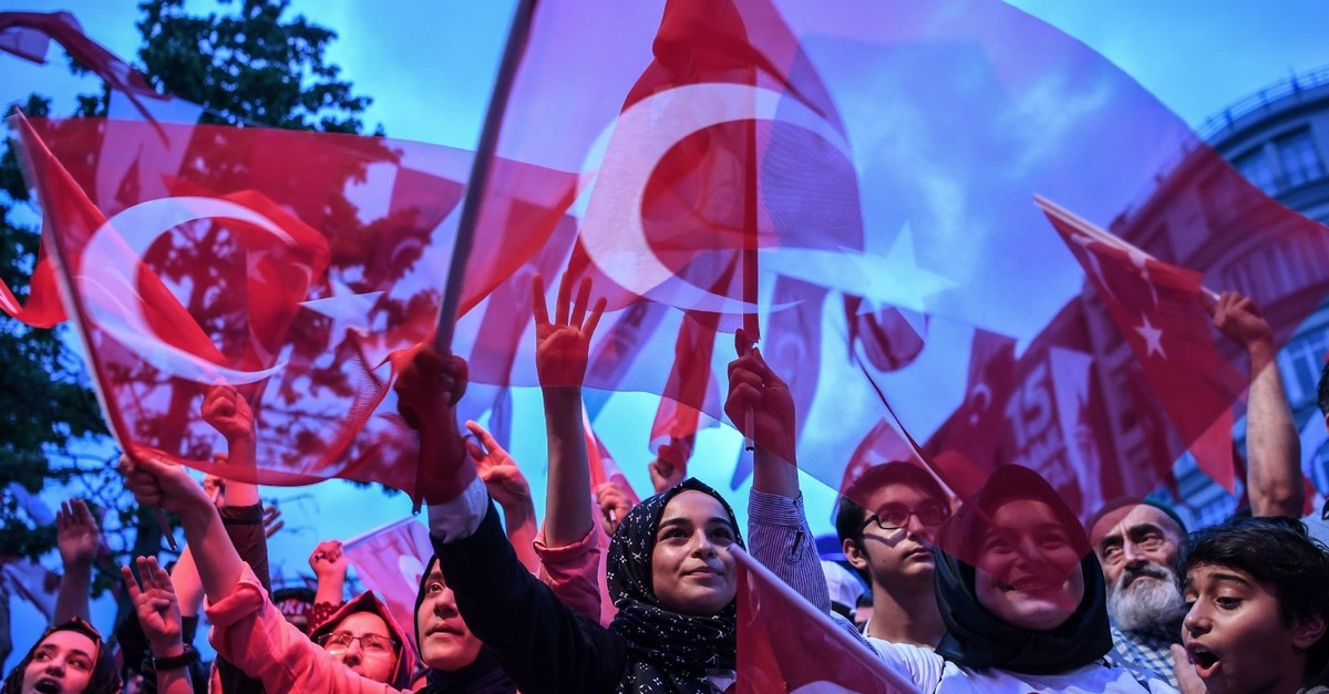People wave Turkish flags on the first anniversary of the failed coup attempt, Istanbul, July 16, 2017.
