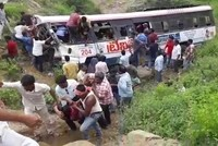 At least 55 killed after overcrowded bus plunges into a valley in India