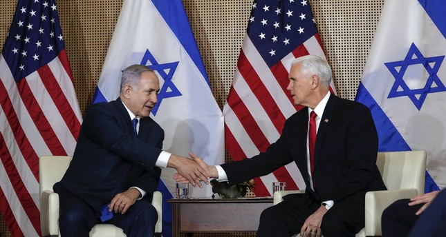 Israeli Prime Minister Benjamin Netanyahu (L) shakes hands with U.S. Vice President Mike Pence at a bilateral meeting in Warsaw, Poland, Feb. 14, 2019.