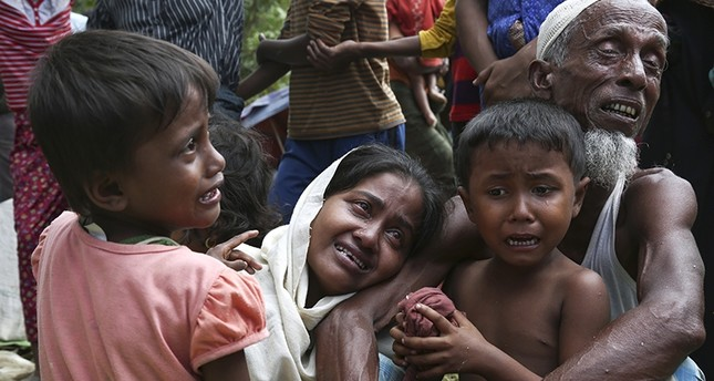A group of Muslim Rohingyas in Ghumdhum, Cox's Bazar weep as Bangladesh border guards (not pictured) order them to leave their makeshift camp and force them out of the country, Aug. 28, 2017. (AP Photo)