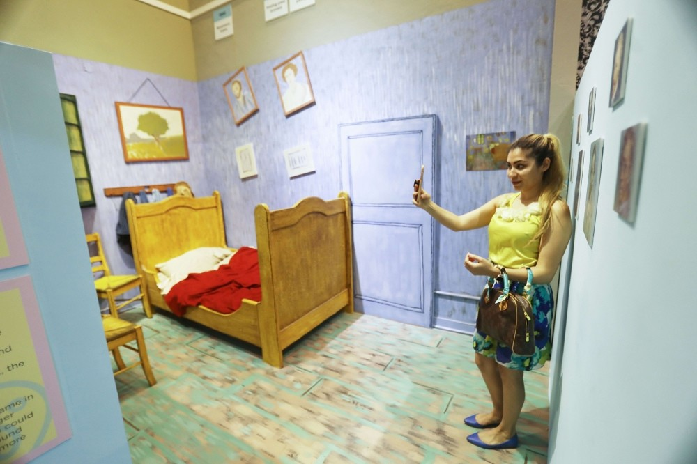 A woman takes a selfie in a Van Gogh-themed installation on opening day at the Museum of Selfies on Sunday.