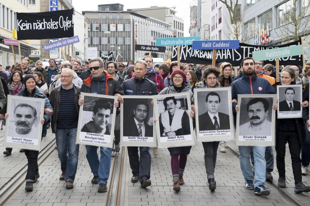 Demonstrators carrying photos of NSU victims and a banner reading ,No Other Victim!, walk through downtown Kassel, Germany on April 6, 2017.