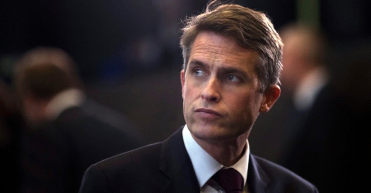 In this Thursday, Oct. 4, 2018 file photo, Britain's Defence Minister Gavin Williamson stands in the main chamber during a gathering of NATO defence ministers at NATO headquarters in Brussels. (AP Photo)