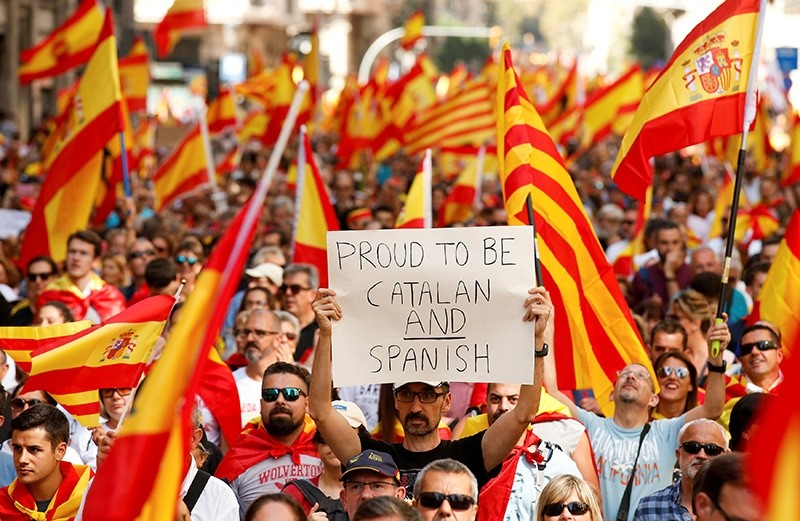 A man holds up a sign while attending a pro-union demonstration organised by the Catalan Civil Society organisation in Barcelona, Spain, Oct. 8, 2017. (Reuters Photo)
