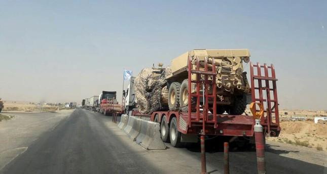 شاحنات تحمل معدات عسكرية على الطريق من العراق إلى سوريا الأناضول