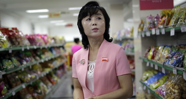 Song Un Pyol, manager at the Potonggang department store, stands in the snacks aisle while being interviewed by The Associated Press in Pyongyang.