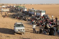 Buses carrying around 7,000 Syrians began crossing into northern Syria late Thursday following a cease-fire struck by Lebanon's Hezbollah movement and the Jabhat Fateh al-Sham group.