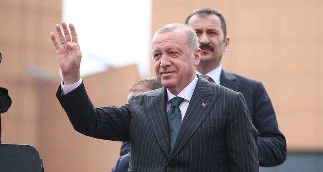 President Recep Tayyip Erdoğan waves at people in Istanbul, June 20, 2019.