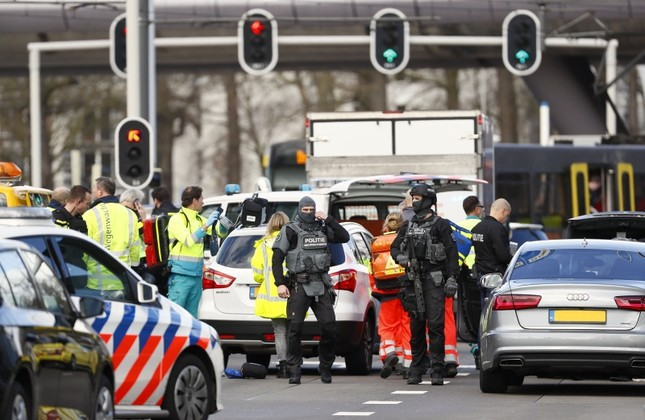 Emergency services stand at the 24 Oktoberplace in Utrecht, on March 18, 2019 where a shooting took place. AFP Photo
